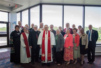Those who are retiring this year pose with Bishop Ough