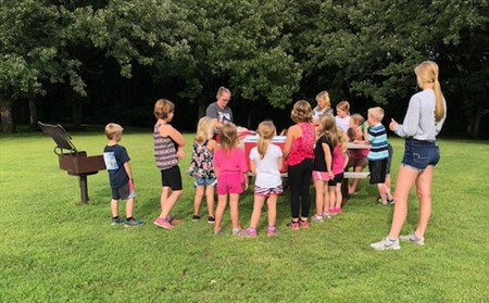 The children enjoy a picnic at a park one eving of the four-day VBS.