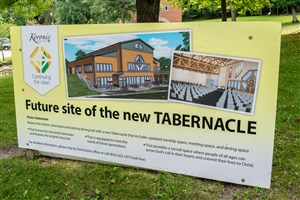 A large sign shows the future location of the Tabernacle at Koronis.