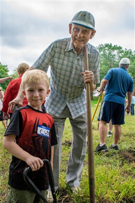 Dwight Rieke has attended Koronis for 91 summers in a row. He broke ground on Labor Day with his great-grandson.