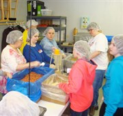Park UMC youth use early release day to pack meals for Kids Against Hunger