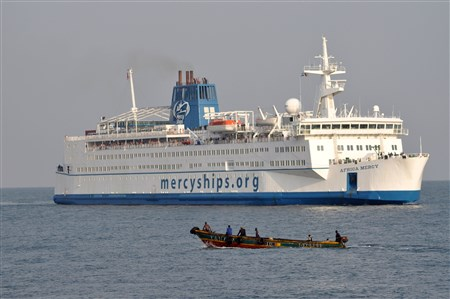 Africa Mercy, a 152 meter ship, is shown at sea.