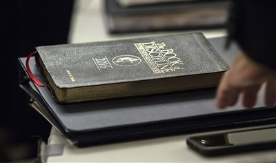 Photo shows Bishop Ough's copy of the Book of Discipline.